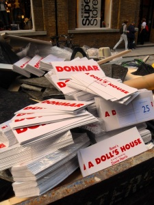 The flyers of A Dolls House in a skip
